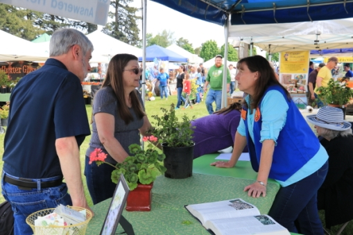 Jane helps some clients at the Ask a Master Gardener Booth